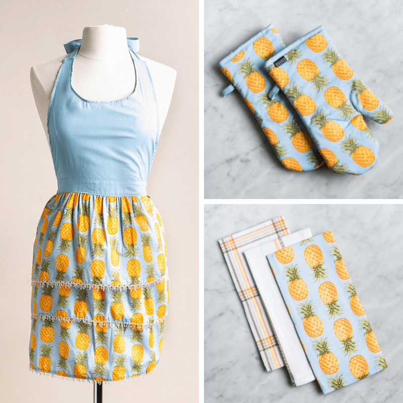 pineapple print apron, oven mitts, and kitchen towels