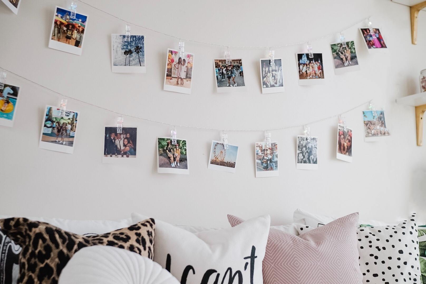 string lights with clothespins full of polaroid photos great for dorm room decor