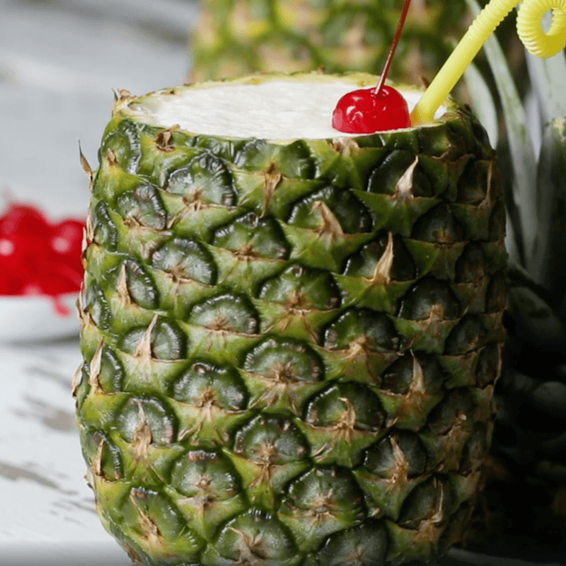 pina colada in a cored pineapple cup
