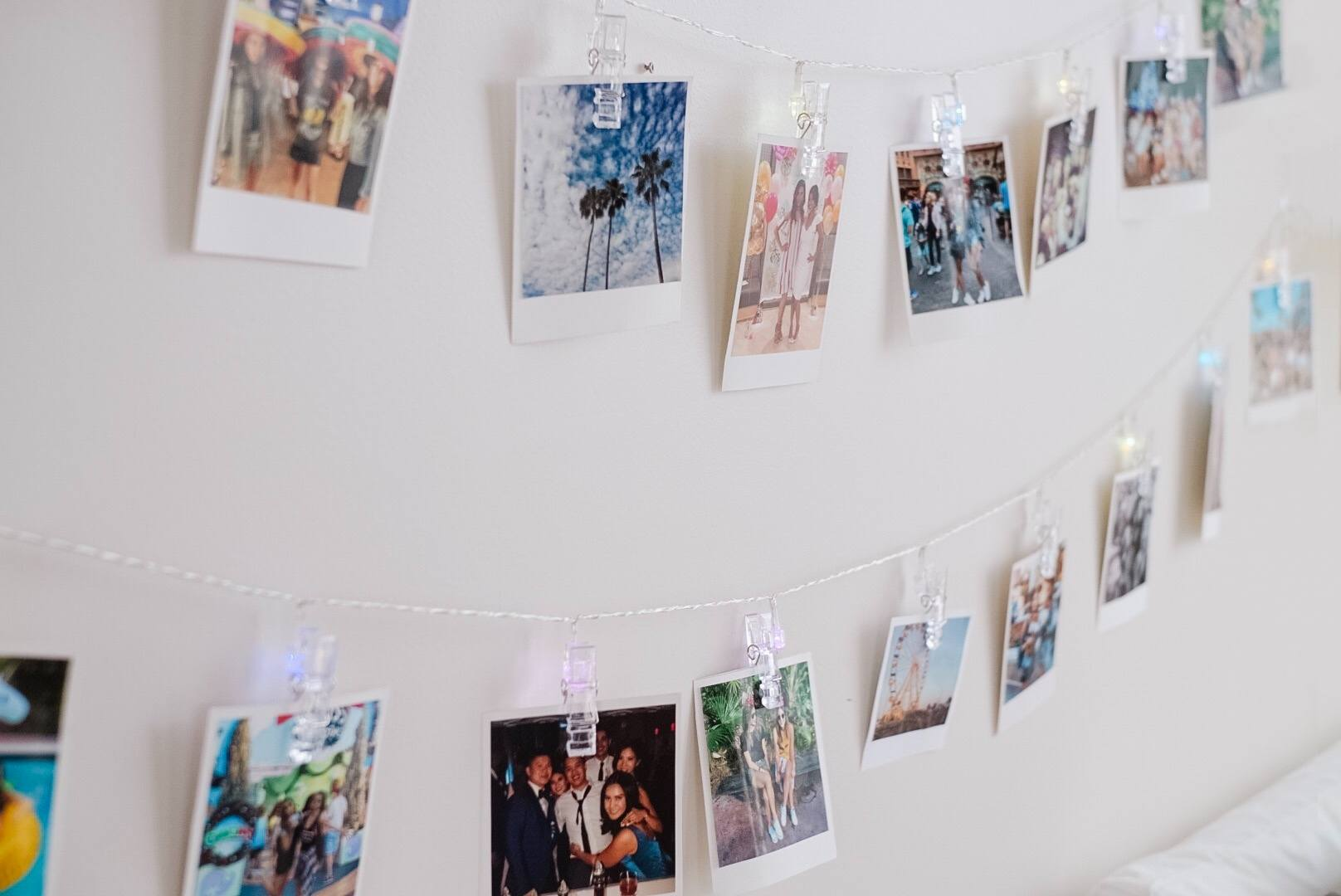 string lights with clothespins full of polaroid photos