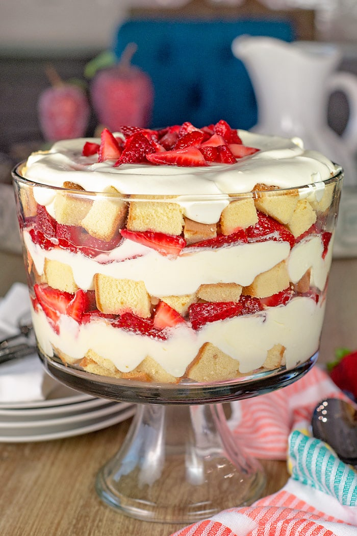 strawberry trifle in a footed trifle bowl