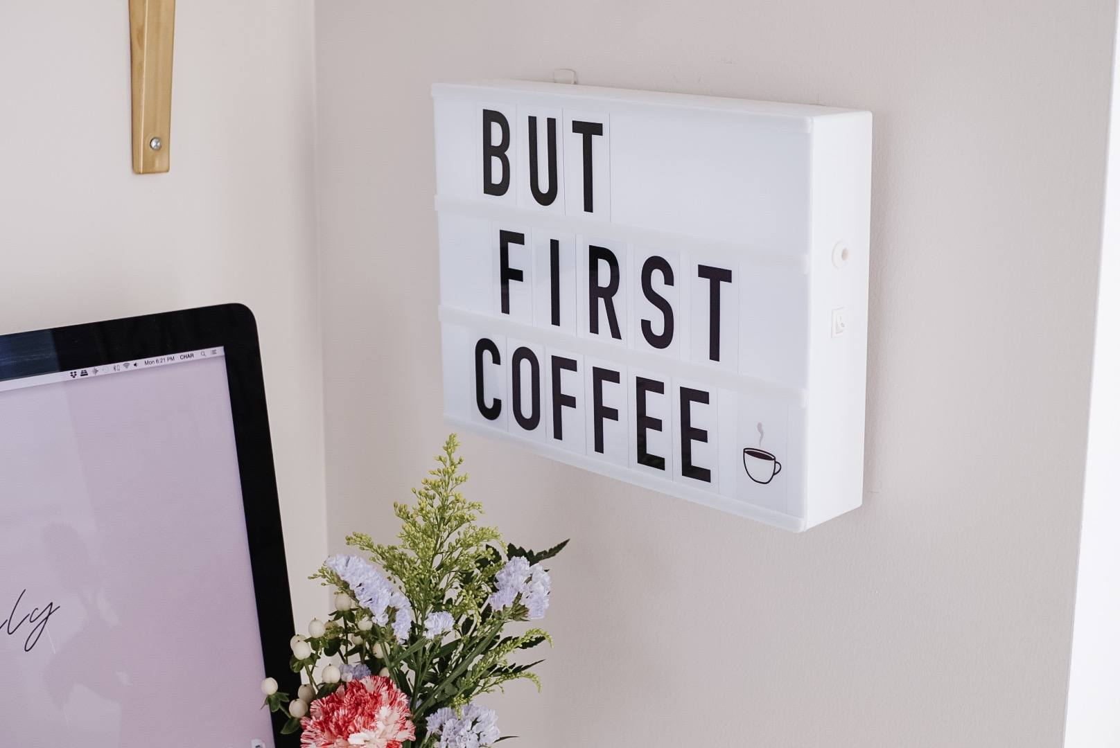 "white letter box wall mounted with the phrase ""but first coffee"""
