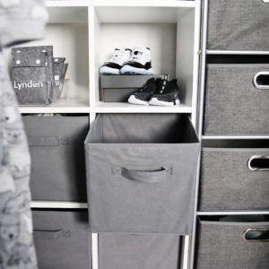 grey storage bin inside a shelf