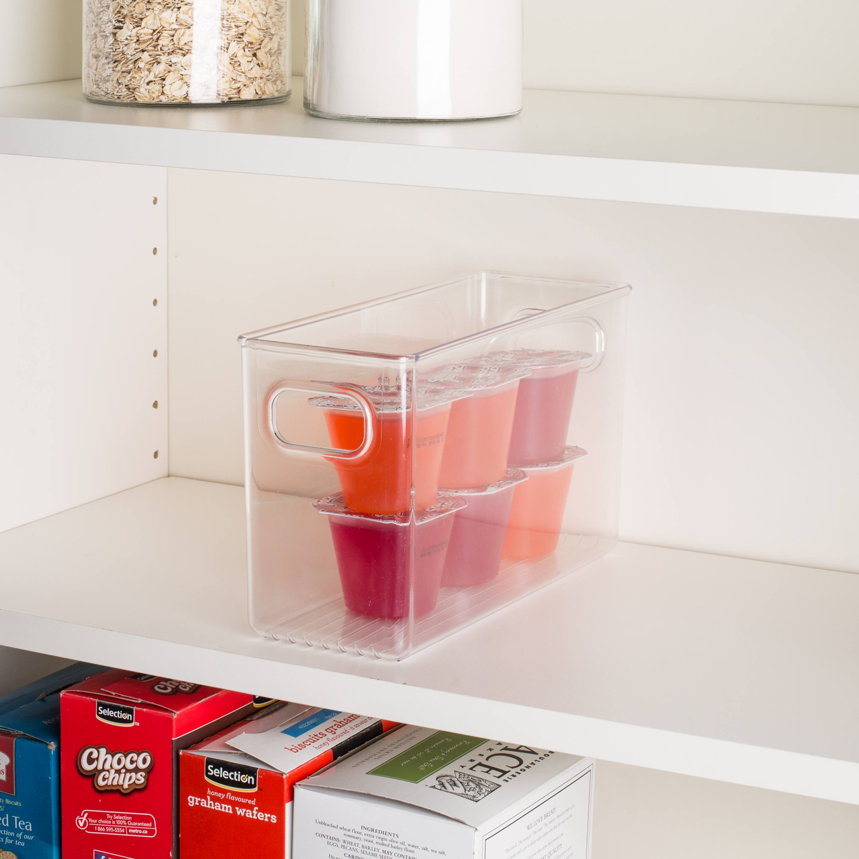 clear bin on a shelf with jello cups