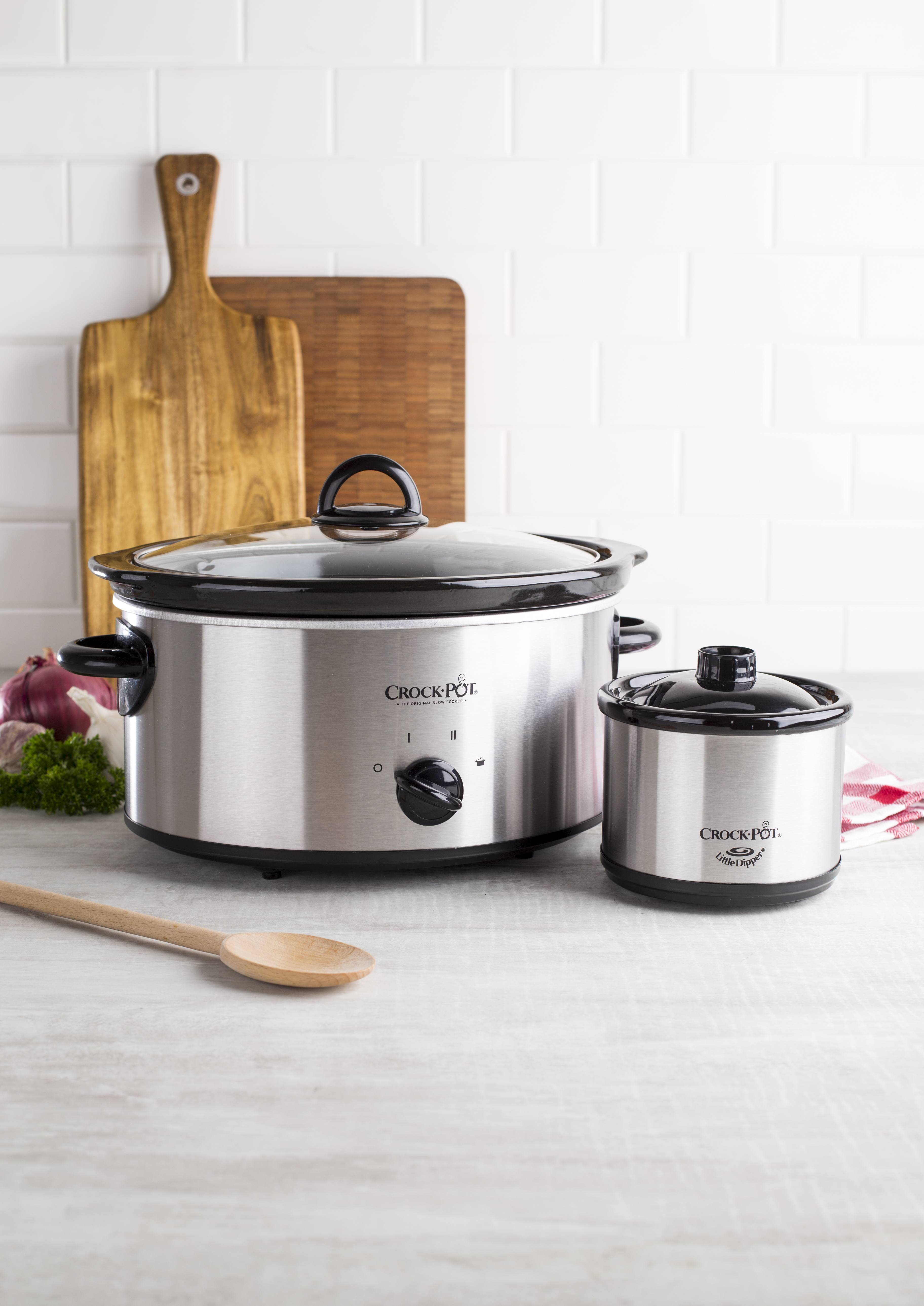 large crock pot slower cooker next to small little dipper