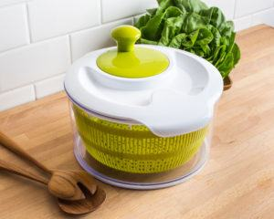 white and green salad spinner