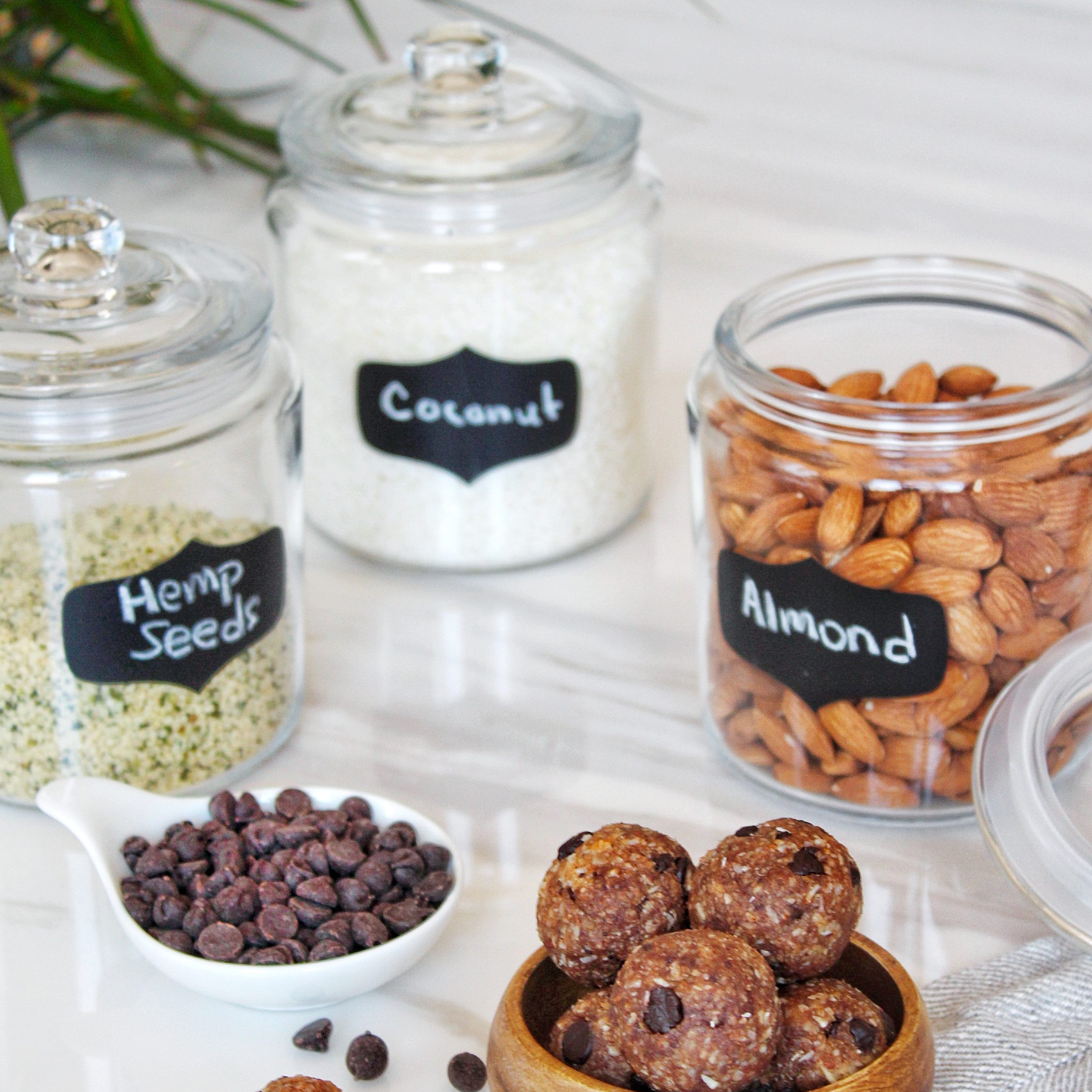 glass canisters with lids and chalkboard labels, keto-friendly kitchen storage