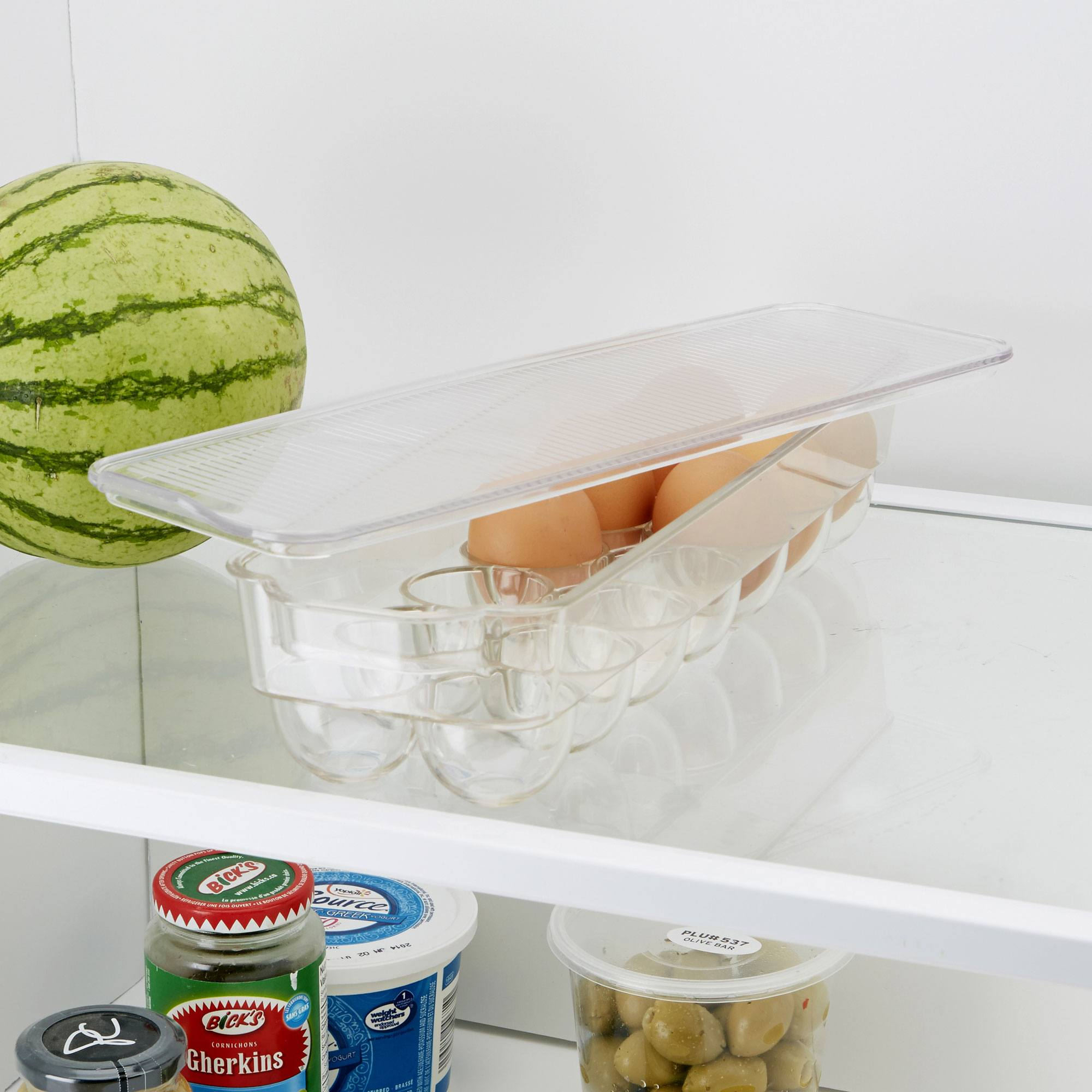 clear egg holder in the fridge with eggs