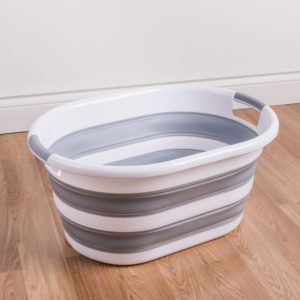 grey and white collapsible laundry basket