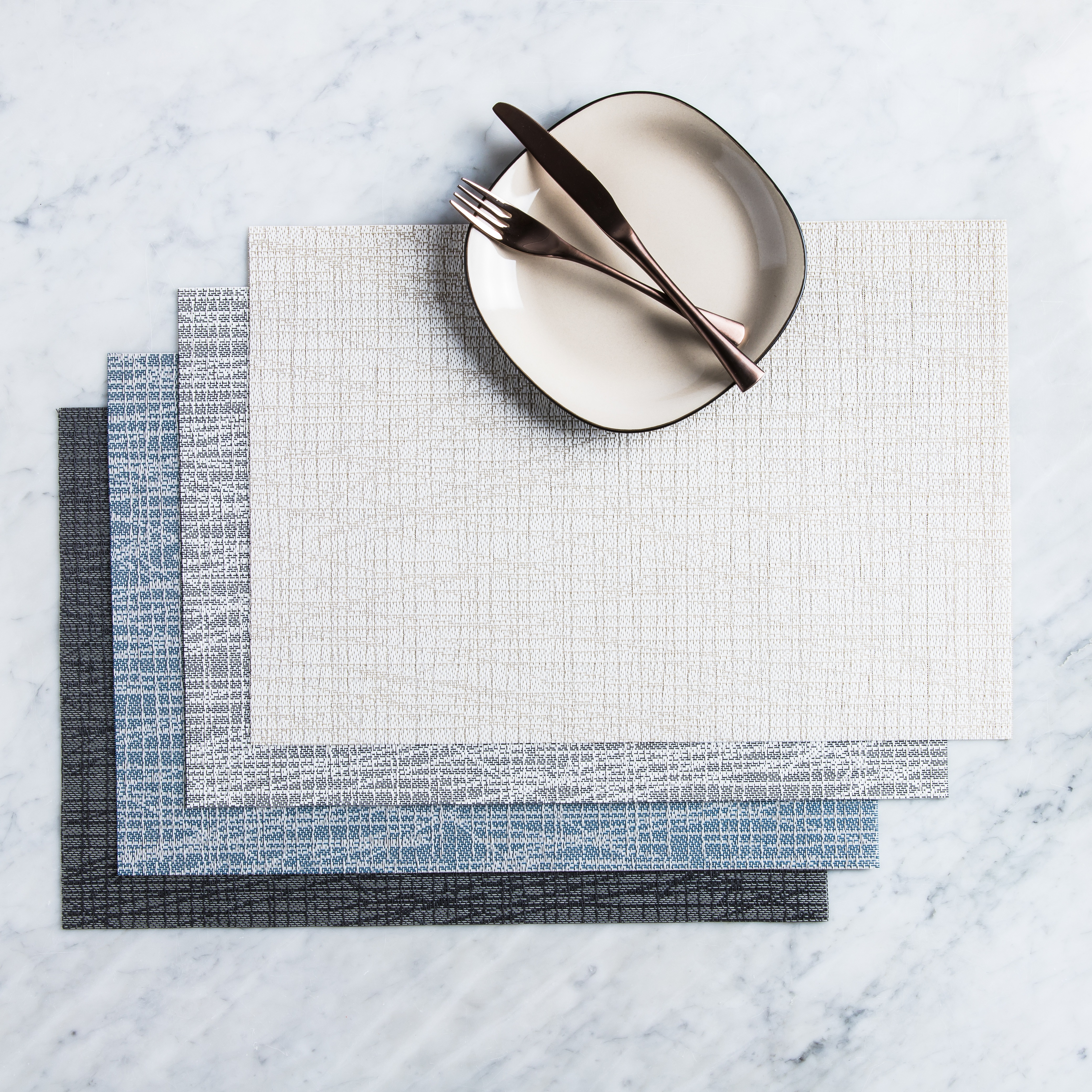 four different coloured placemats