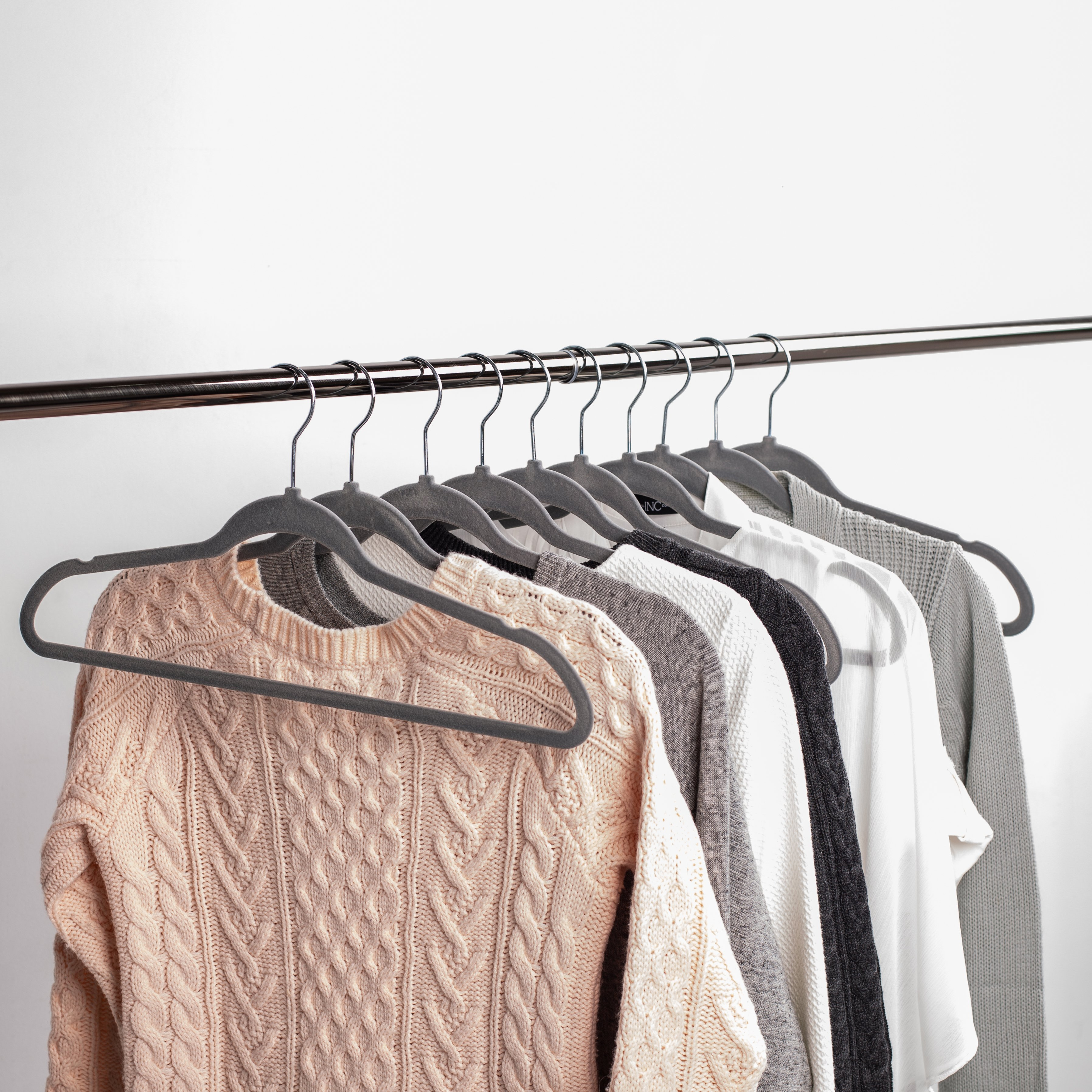 grey velvet hangers with clothes