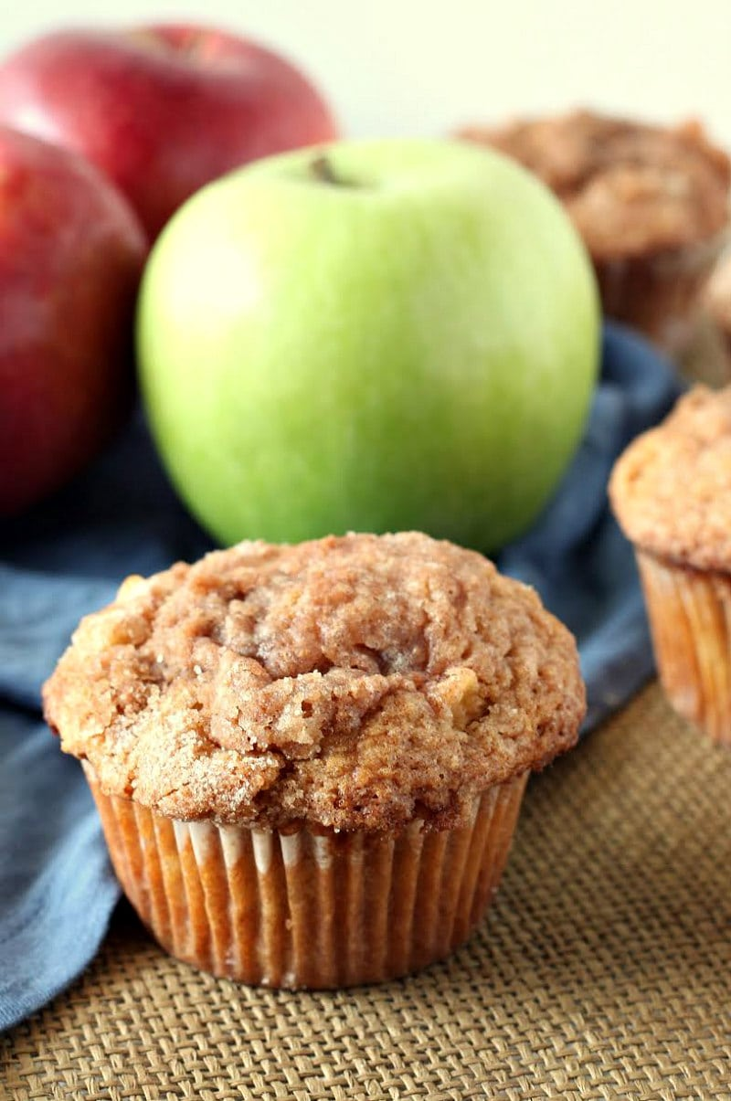 apple cinnamon muffin with apples in the background