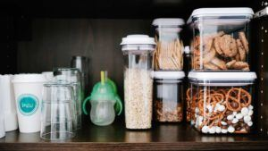 clear containers with snacks on a shelf