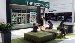 people walking by a store in white oaks mall