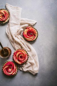 tartlets with slices of apples made to look like a rose