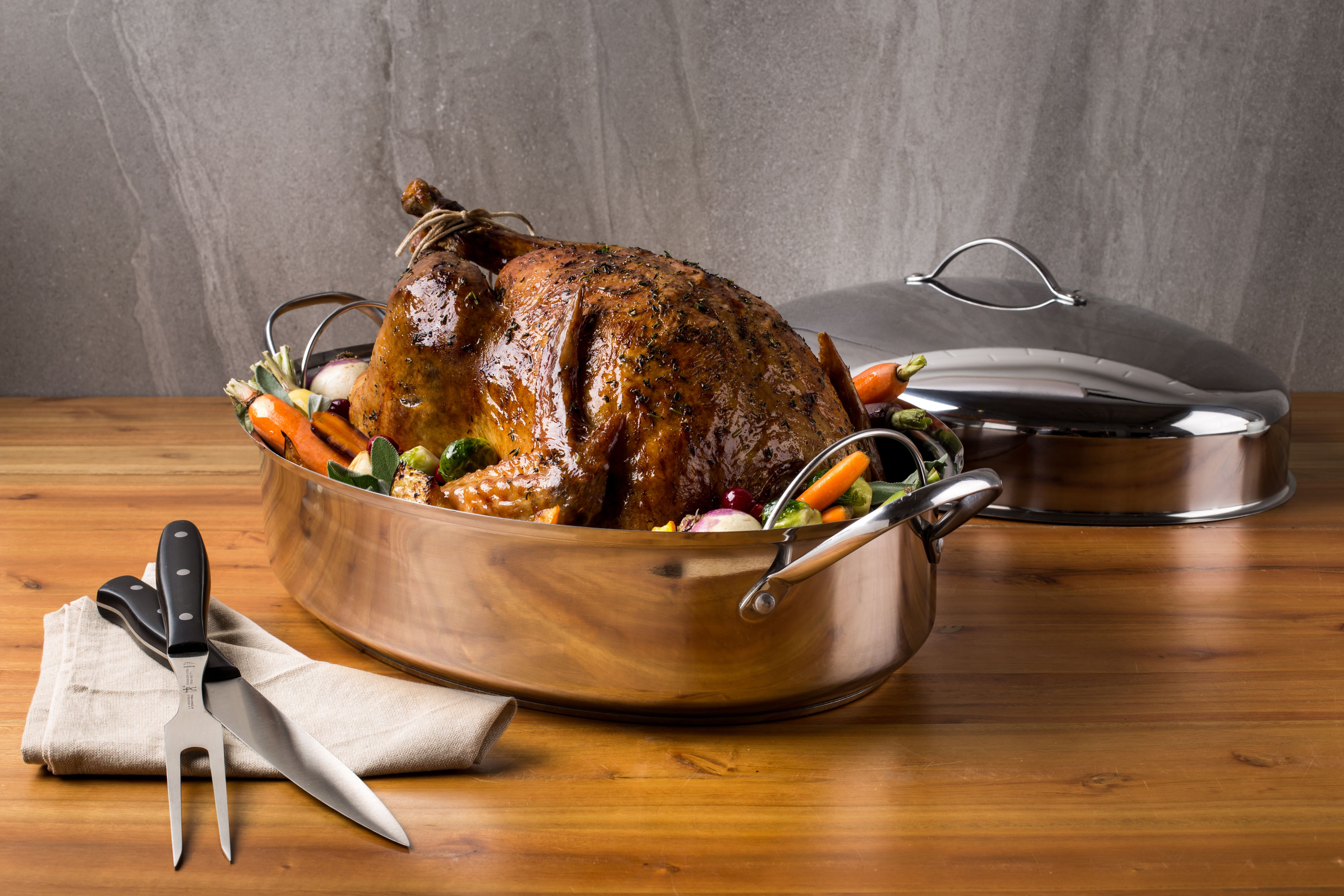 stainless steel hi-dome roaster with prepared turkey inside