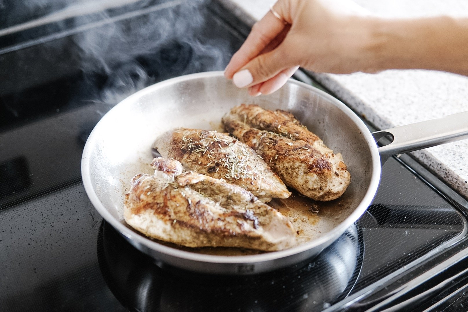 """glazed balsamic chicken in the joy cookware 9"""" fry pan on a stove top"""