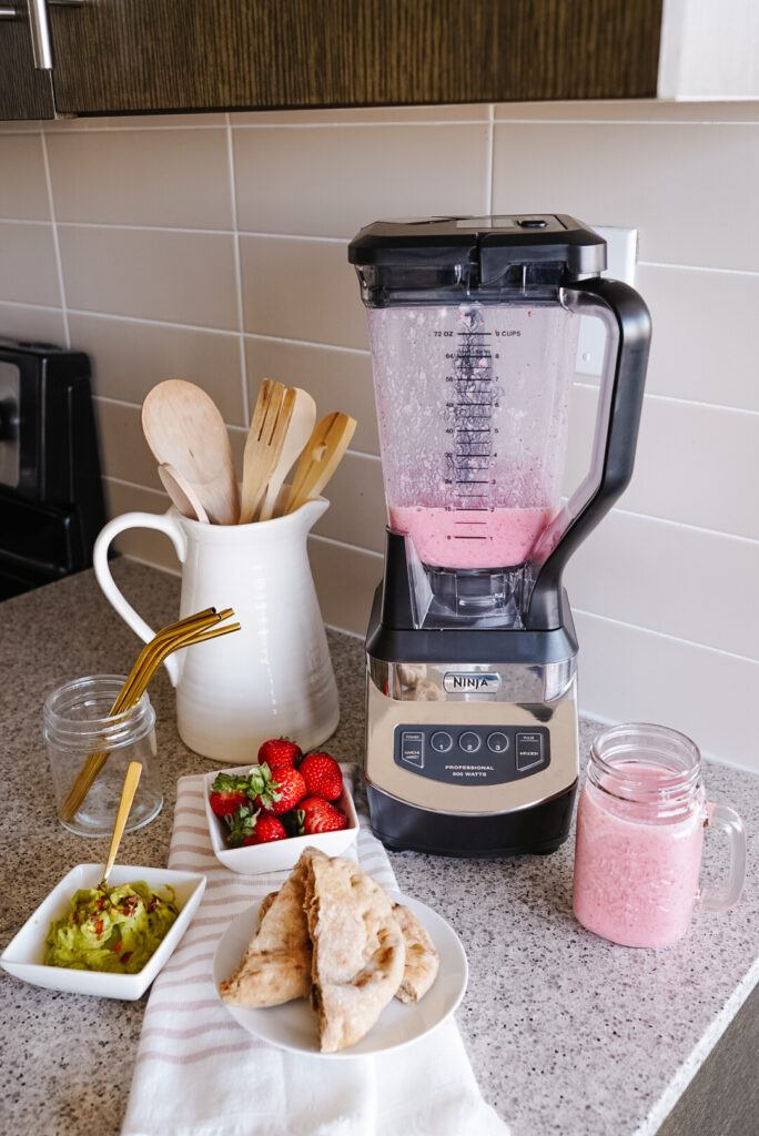 professional ninja blender on counter with smoothie ingredients