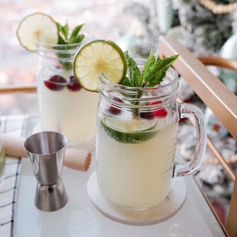 cocktails in mason jars garnished with lime