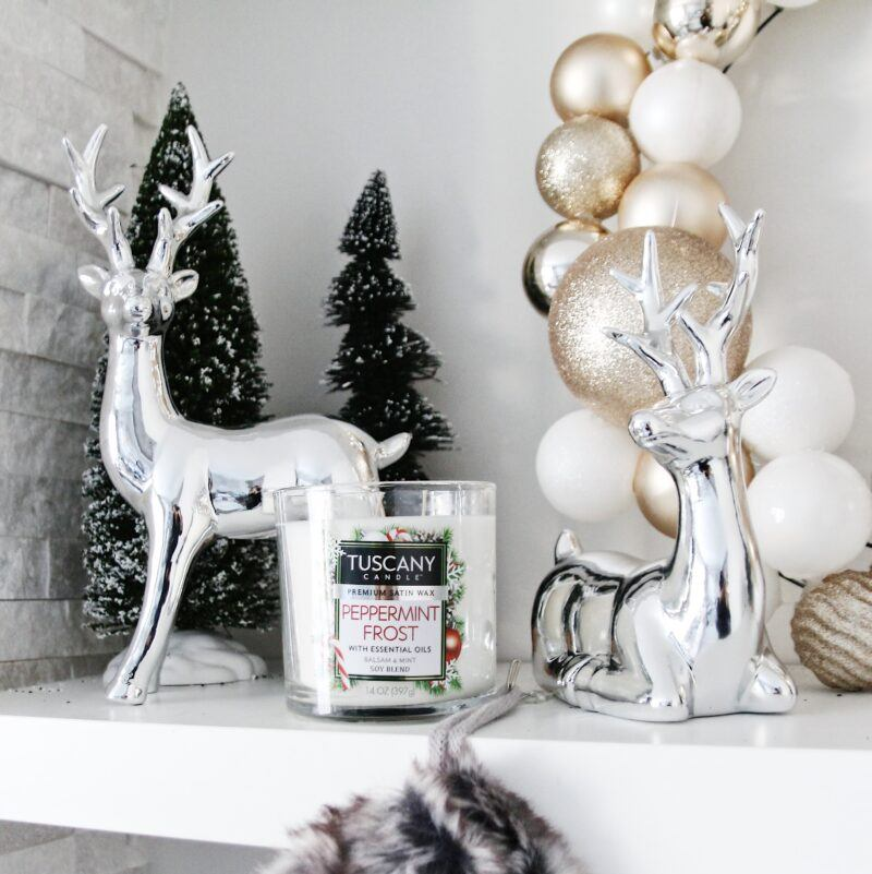 chrome reindeer with peppermint frost candle on shelf
