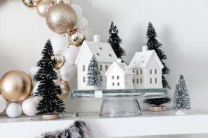 christmas village displayed on cake plate