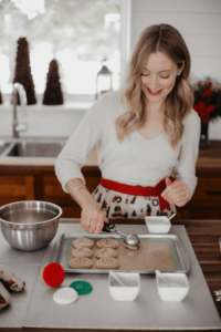 Jenny of Little Love Lifestyle scooping cookie dough