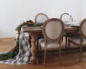 holiday tablecloth draped over table with garland