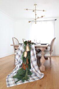 holiday tablecloth draped over table with garland side view